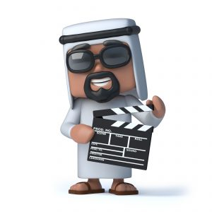 3d render of an Arab holding a clapperboard